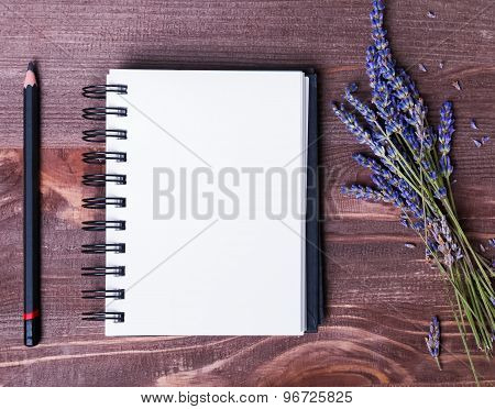 Lavender Flowers, Empty Notepad And Pensil On Wooden Table
