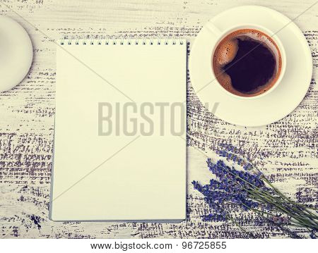 Empty Notepad, Cup Of Coffee And Lavender Flowers On White Wooden Table