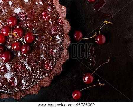 Tart With Dark Chocolate Ganache And Cherries.