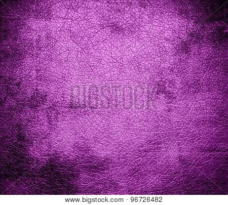 Grunge background of deep mauve leather texture
