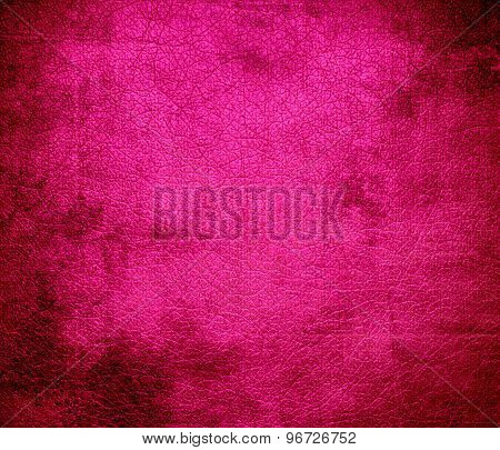 Grunge background of deep pink leather texture