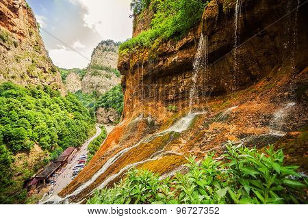 top tier of Chegem waterfalls in canyon.