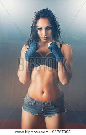 Sexy woman boxer with smoky eyes