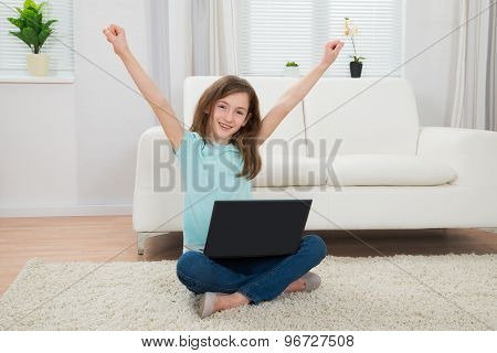Girl Raising Arms With Laptop