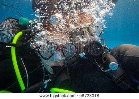 Portrait of full equiped divers in swimming pool
