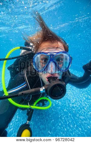Portrait of full equiped diver in swimming pool