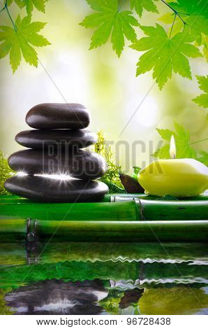 Stones And Candle Reflected In Water Massage And Relax