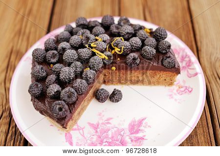 Delicious Homemade Chocolate Pie With Fresh Blackberries, Icing Sugar And Lemon Peel Missing One Pie