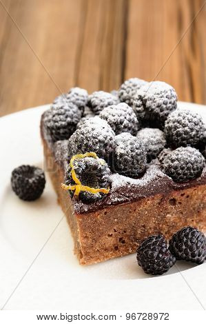 Piece Of Delicious Homemade Chocolate Pie With Ganache, Fresh Blackberries And Lemon Peel Decorated