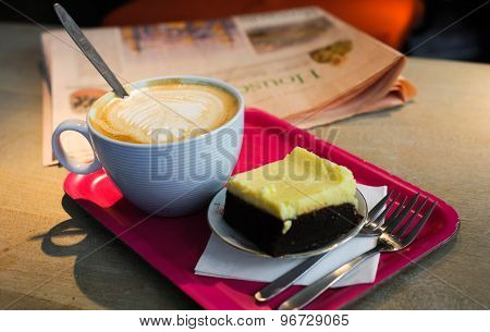 Cup of coffee with milk and brownie cake