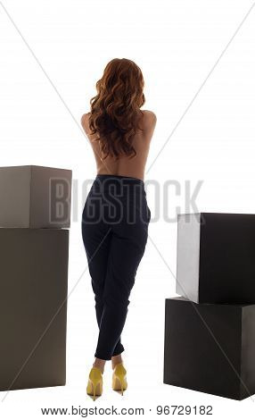 Back view of slim model posing in trendy trousers