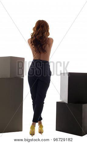 Back view of slim model posing in trendy trousers