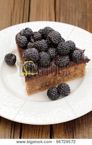 Piece Of Tasty Chocolate Pie With Ganache, Decorated With Fresh Blackberries, Lemon Peel And Icing S