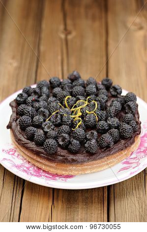 Fresh Homemade Chocolate Pie With Ganache, Decorated With Fresh Blackberries, Lemon Peel And Icing S