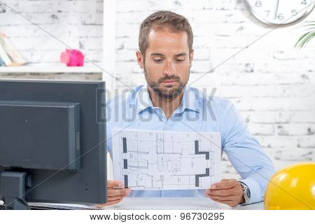 Young Engineer Working On His Computer