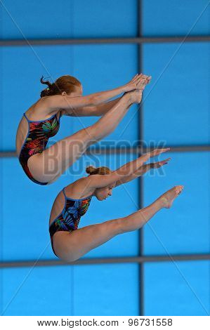 LONDON, GREAT BRITAIN - APRIL 25 2015: Maria Polyakova and Kristina Ilinykh of Russia competing in the women synchro 10m platform during the FINA/NVC Diving World Series at the London Aquatics Centre