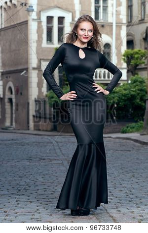 Beautiful luxurious woman in elegant evening gown outdoor