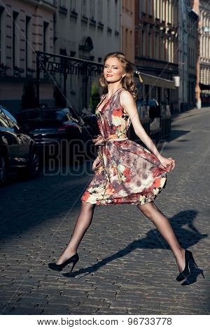 Beautiful woman in floral short dress outdoor