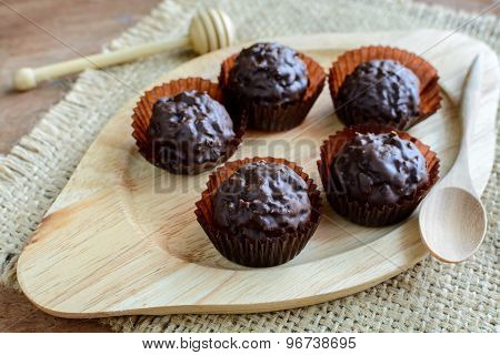 Chocolate Balls On Wooden Plate And Spoon