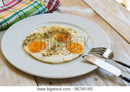 Fried eggs in rustic style