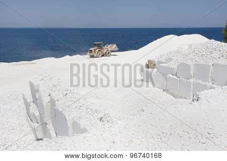 Bulldozer At Marble Quarry On Island