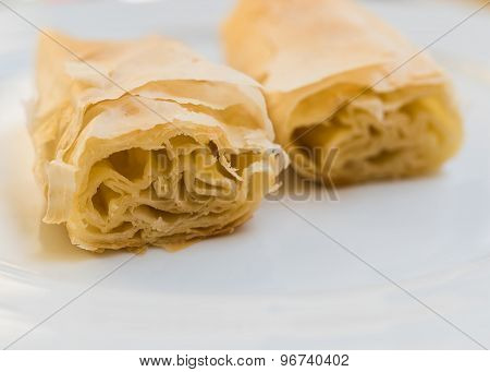 Sliced Mediterranean rolled pita with cheese
