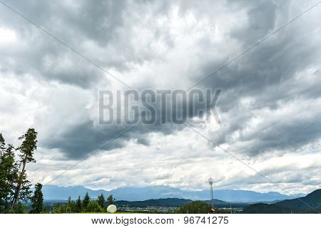 Thunderstorm Clouds Over A Village