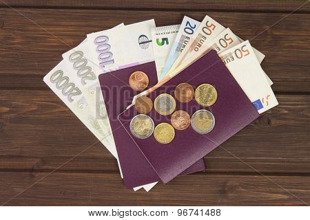Passport and money on wooden table. Valid EURO banknotes, coins and banknotes Czech.