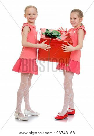 Two girls hold the gift