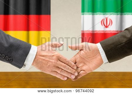 Representatives Of Germany And Iran Shake Hands