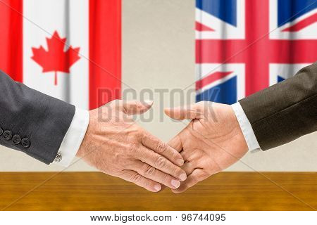 Representatives Of Canada And The Uk Shake Hands