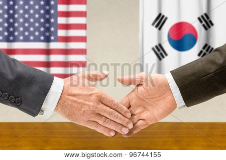 Representatives Of The Usa And South Korea Shake Hands