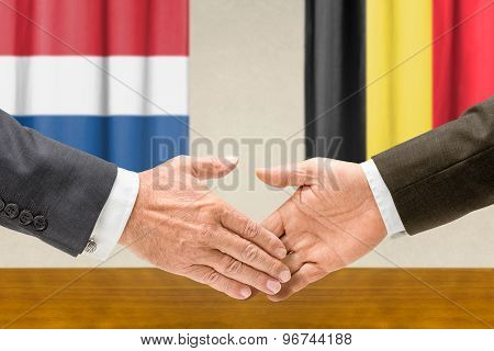 Representatives Of The Netherlands And Belgium Shake Hands