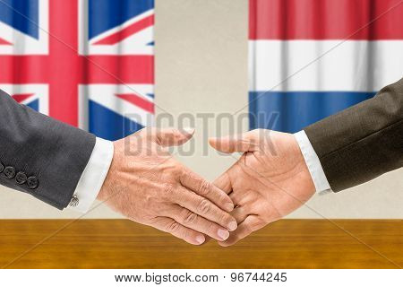 Representatives Of The Uk And The Netherlands Shake Hands