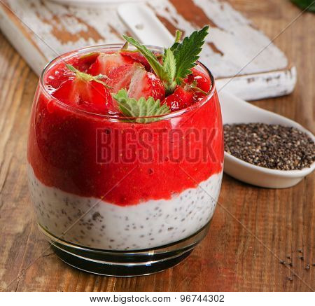 Chia Seed Pudding With Strawberries On  Rustic Wooden Table.