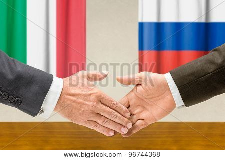 Representatives Of Italy And Russia Shake Hands
