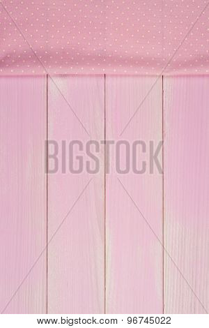 Pink Towel Over Wooden Table