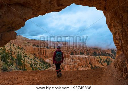 Girl Backpacker Under Sandstone Arch Peek-a-boo Bryce