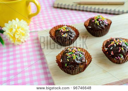Chocolate Balls With Fancy Topping On Wooden Plate And Spoon