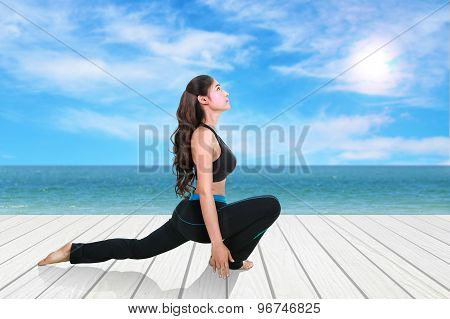Woman Doing Yoga Exercise On Wood Floor With Sea And Sky