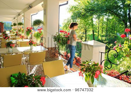 Woman In Outdoor Restaurant