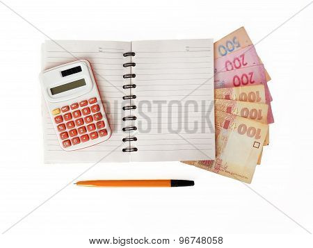 Ukrainian money (hryvnia) and a notebook with a calculator