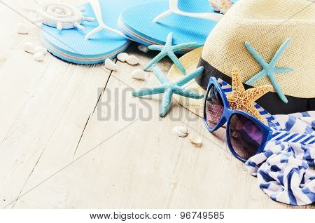 Summer Holiday Setting With Straw Hat And Flip Flops
