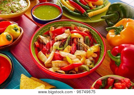 Chicken fajitas with mexican food guacamole pico de gallo chili peppers sauce and nachos