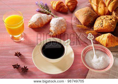Coffe breakfast with orange juice croissant bread and yogurt