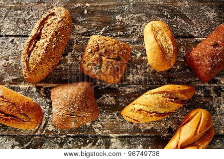 Bread loaf mixed in a rustic wood and wheat flour aerial view