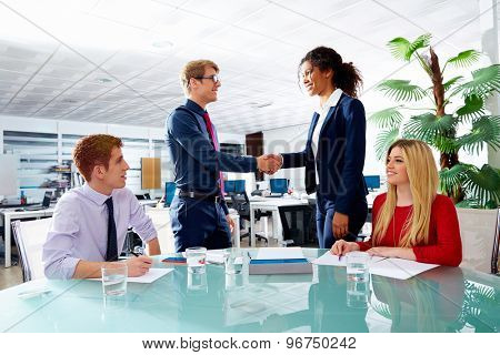 Executive handshake businessman and african businesswoman in office meeting