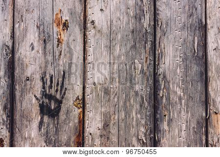 Hand print on an old wooden wall