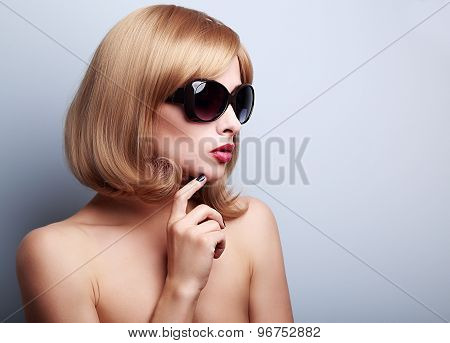 Sexy Female Model Profile In Fashion Sunglasses With Blond Short Hair Style