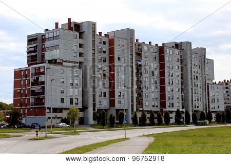 Industrial apartment building with grass area in front